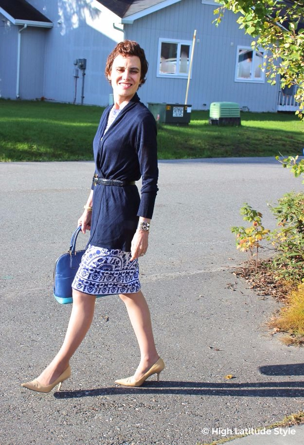 midlife woman in blue and white dress with cardigan work outfit