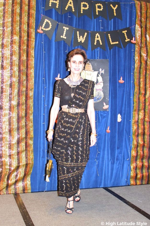 black embroidered saree with lots of accessories