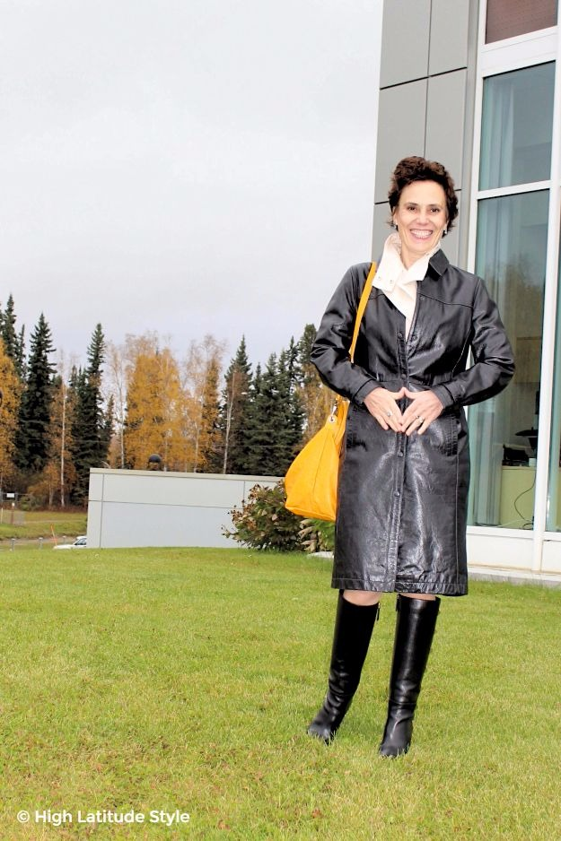 posh chic midlife woman in leather trench coat