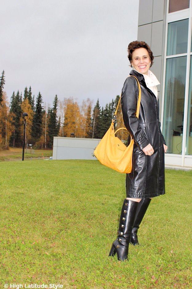 posh midlife woman with nappa coat and yellow bag