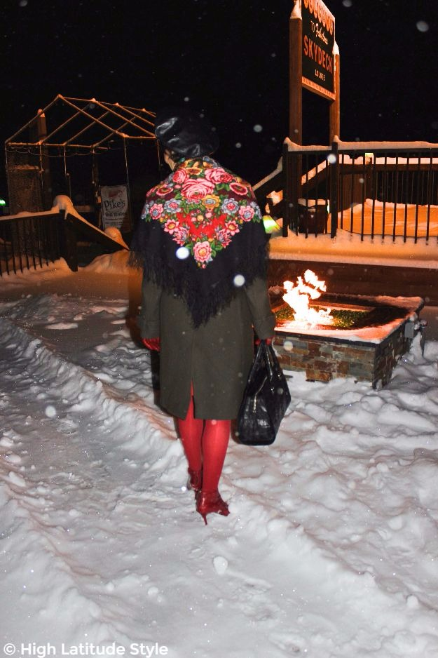midlife lady in outerwear at a fire