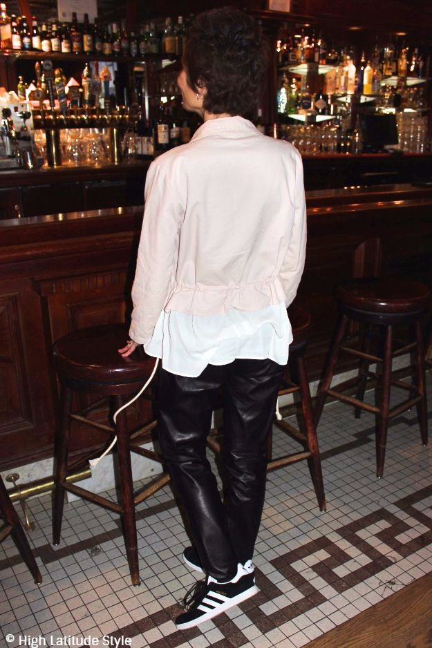 Woman in a casual going out look in a bar