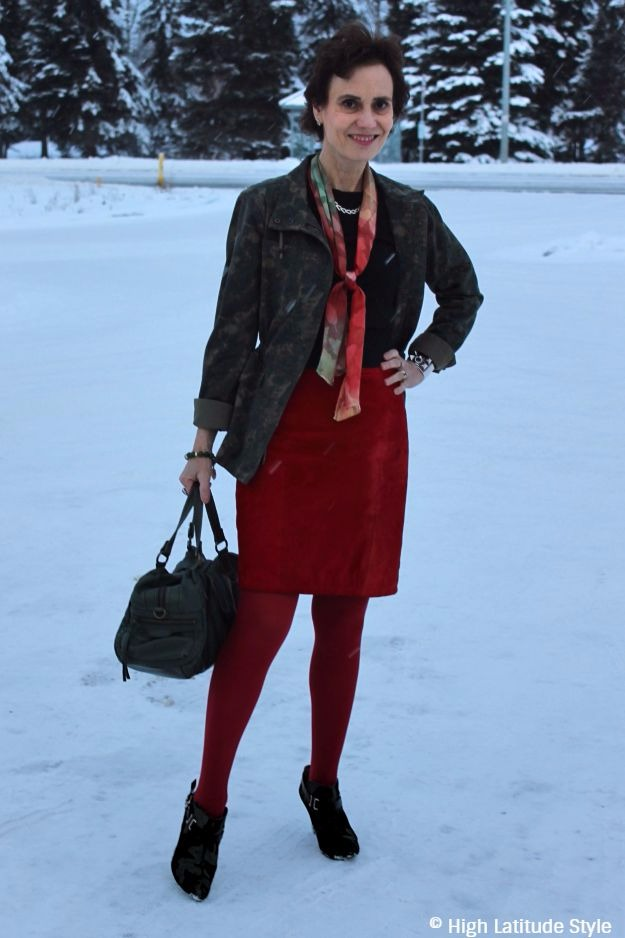 mature woman in red and olive outfit