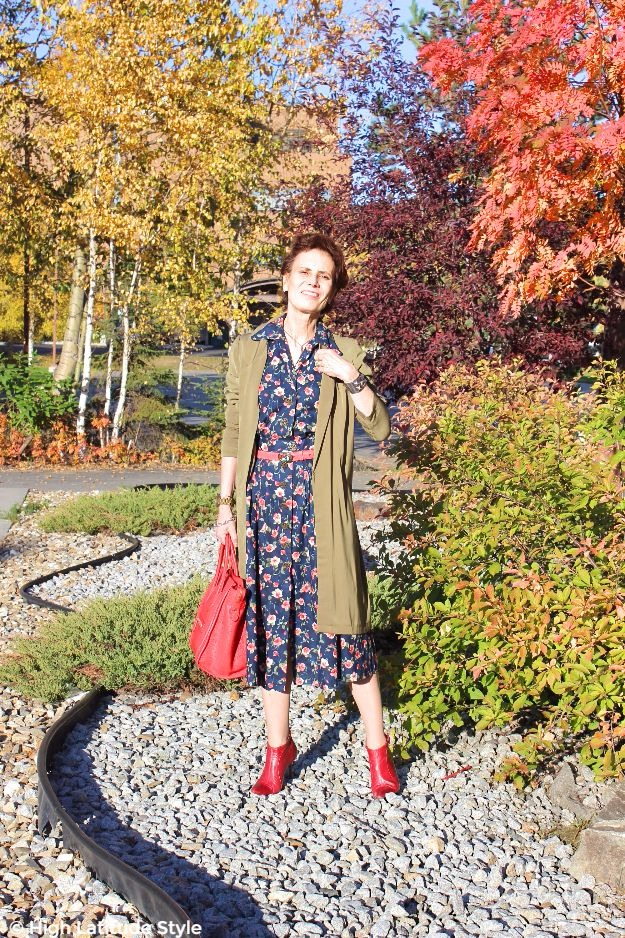 midlife woman in a posh chic in floral dress with long jacket