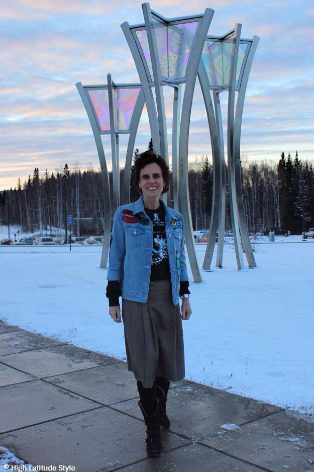 woman over 40 in sequin embellished denim jacket with glen check skirt