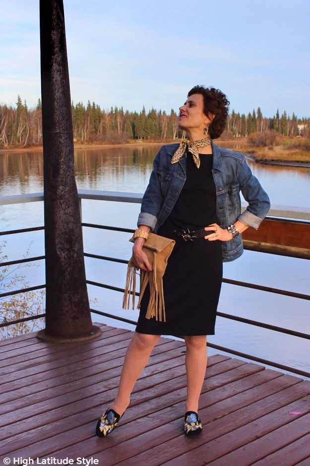 mature woman in LBD with denim jacket for brunch look