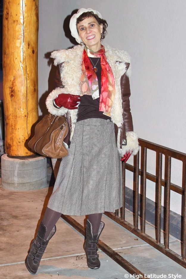 Posh chic midlife woman in winter outerwear with colorful scarf
