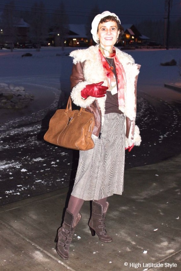 midlife woman in posh chic look with Uno Alla Volta scarf in winter wonderland