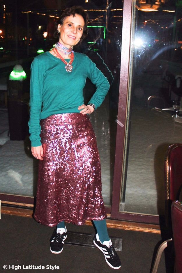 midlife woman in Alaska street style with sequin skirt and sneakers