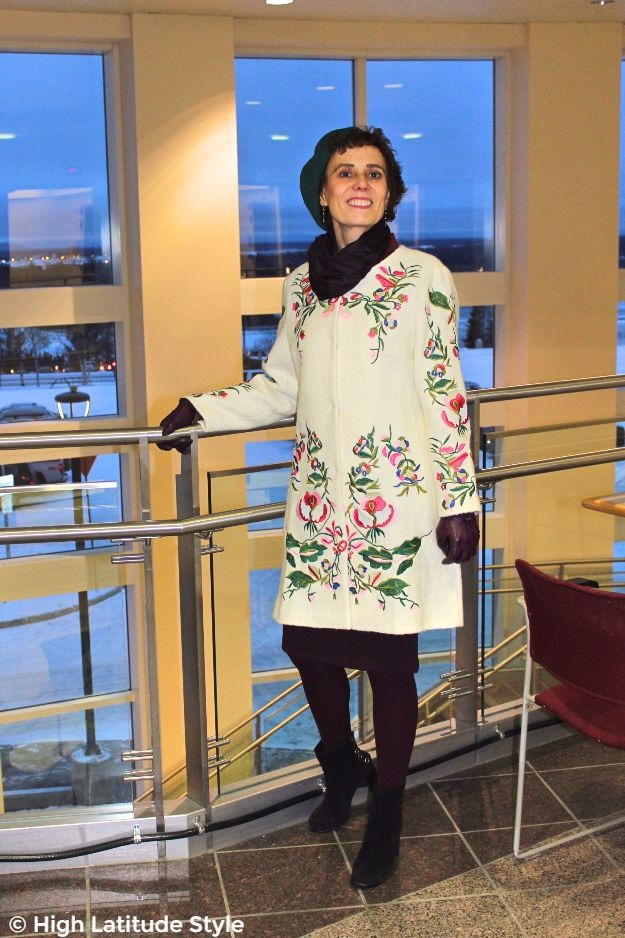 mature lady in embroidered coat