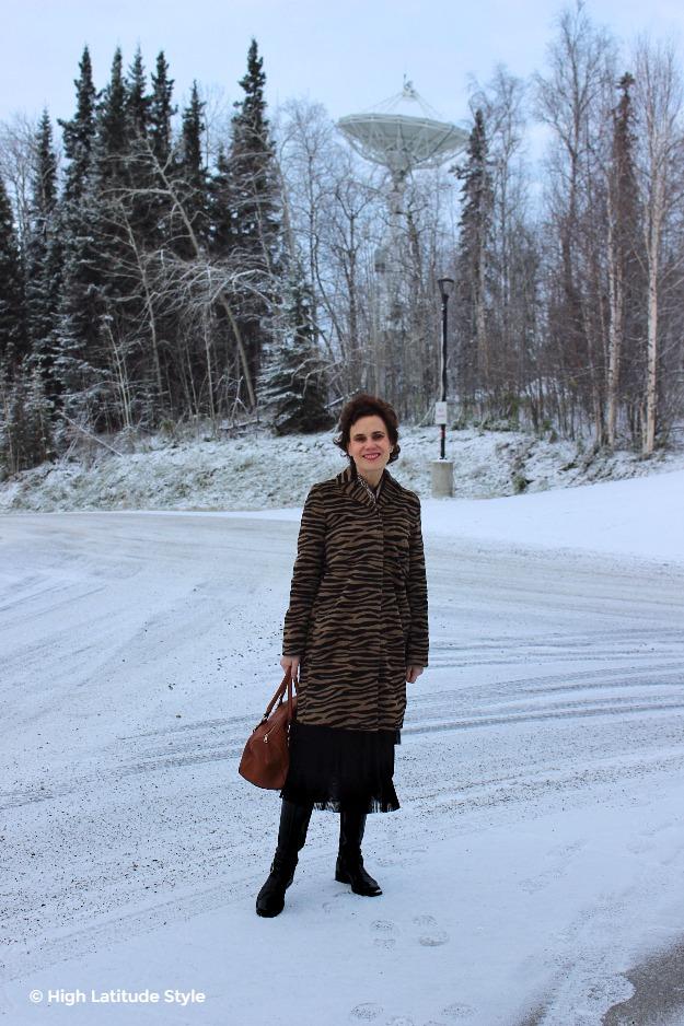 midlife woman in posh chic zebra print coat
